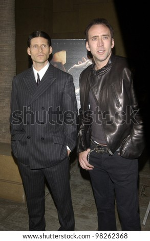 Actors CRISPIN GLOVER (left) & NICOLAS CAGE at the Los Angeles premiere of Glover's new movie Willard. March 12, 2003  Paul Smith / Featureflash