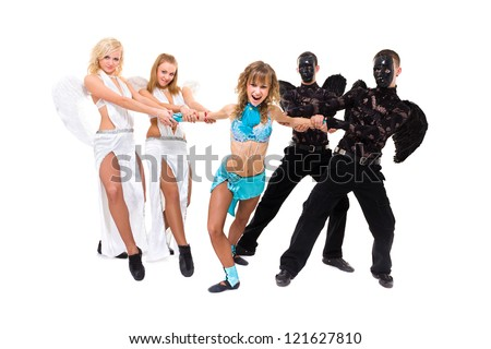 Actors dressed as angels and demons posing on an isolated white background - stock photo