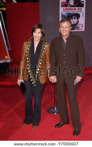 Actress ANNE ARCHER & husband at the world premiere, in Hollywood, of Ladder 49. September 20, 2004