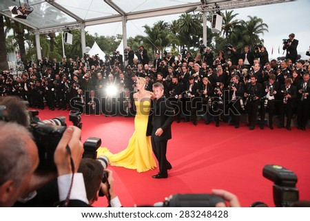 Actress Charlize Theron and Sean Penn attend the 'Mad Max : Fury Road' premiere during the 68th annual Cannes Film Festival on May 15, 2015 in Cannes, France. - stock photo