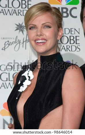Actress CHARLIZE THERON at the 2001 Golden Globe Awards at the Beverly Hilton Hotel. 21JAN2001.   Paul Smith/Featureflash - stock photo