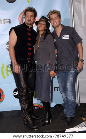 Actress EMMANUELLE CHRIQUI with NSync stars JOEY FATONE (left) & LANCE BASS at the 2001 Radio Music Awards at the Aladdin Hotel & Casino, Las Vegas. 26OCT2001.  Paul Smith/Featureflash