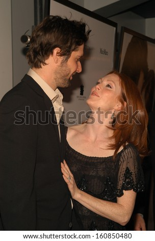 Actress Julianne Moore and husband Bart Freundlich attend the world premiere screening of New Line Cinema's LAWS OF ATTRACTION at Loews Astor Plaza April 22, 2004 in New York City
