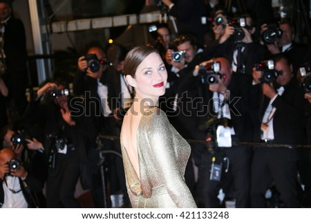 Actress Marion Cotillard leaves the 'From The Land Of The Moon (Mal De Pierres)' premiere during the 69th annual Cannes Film Festival at the Palais des Festivals on May 15, 2016 in Cannes, France. - stock photo