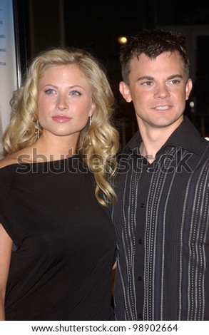 Actress MOLLY SCHADE & actor TRAVIS WESTER at the Los Angeles premiere of their new movie EuroTrip. February 17, 2004
