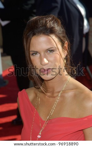 Actress RHONA MITRA at the 2004 Primetime Creative Arts Emmy Awards at the Shrine Auditorium, Los Angeles. September 12, 2004