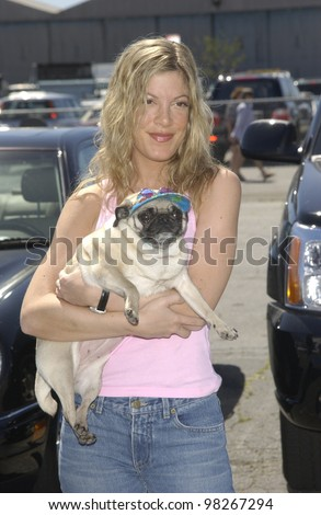 Actress TORI SPELLING & dog at the Best Friends Lint Roller Party at Santa Monica Airport, California. The event was held to benefit the Best Friends Animal Sanctuary. - stock photo