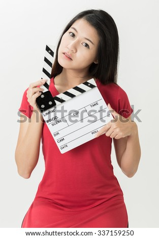 Actresses woman holding the  clapper-board on a white background.