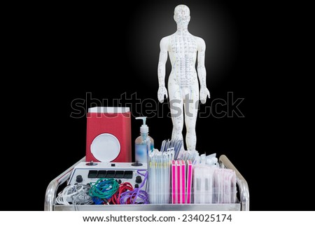 acupuncture equipment isolated on black background with clipping path - stock photo