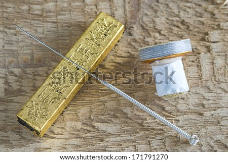 Acupuncture needle with moxa cone - stock photo
