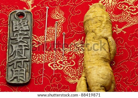 Acupuncture needles and Ginseng - stock photo