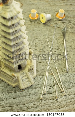 acupuncture needles and moxibustion cones - stock photo
