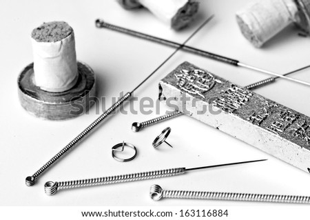 acupuncture needles and moxibustion tools - stock photo