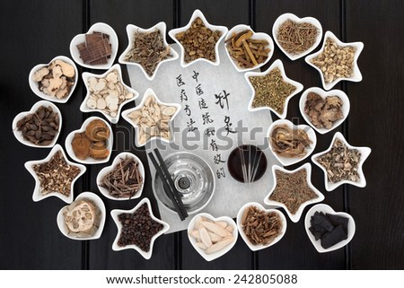 Acupuncture needles, chinese herbal medicine selection and moxa sticks with calligraphy script. Translation reads as acupuncture chinese medicine is a traditional and effective medical solution. - stock photo