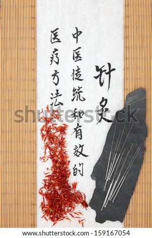 Acupuncture needles with safflower and mandarin script on rice paper over bamboo. Hong hua. Translation describes acupuncture chinese medicine as a traditional and effective medical solution. - stock photo