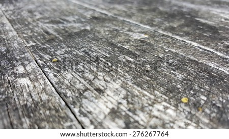 Acute angle shot of exposed to elements grainy natural wood surface, extremely shallow depth of field - stock photo