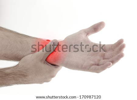 Acute pain in a man palm. Male holding hand to spot of palm-ache. Concept photo with Color Enhanced blue skin with read spot indicating location of the pain. Isolation on a white background.