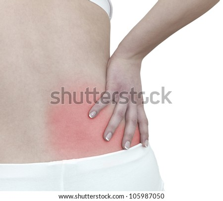Acute pain in a woman back. Female from behind holding hand to spot of back pain. - stock photo