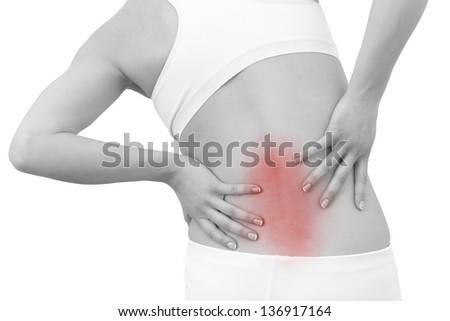 Acute pain in a woman back. Female from behind holding hand to spot of back pain. Concept photo with Color Enhanced skin with read spot indicating location of the pain. Isolation on a white background