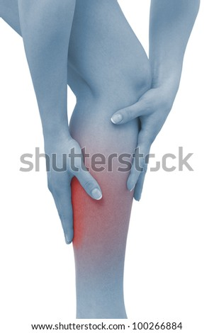Acute pain in a woman calf. Female holding hand to spot of  calf-aches. Concept photo with Color Enhanced blue skin with read spot indicating location of the pain. Isolation on a white background. - stock photo