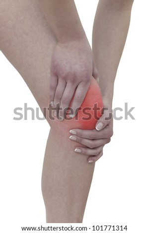 Acute pain in a woman  knee. Female holding hand to spot of knee-aches. Concept photo with Color Enhanced skin with read spot indicating location of the pain. Isolation on a white background. - stock photo