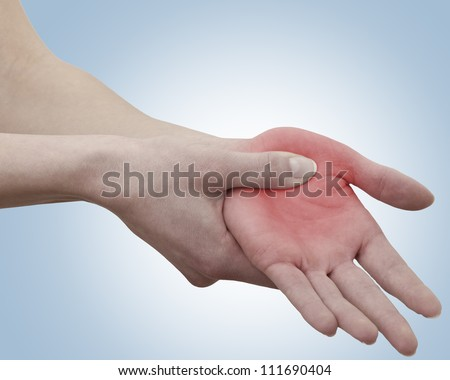 Acute pain in a woman palm. Female holding hand to spot of palm-ache. Concept photo with Color Enhanced skin with read spot indicating location of the pain. - stock photo