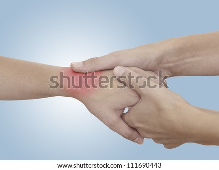 Acute pain in a woman palm. Isolation on a white background. Concept photo with Color Enhanced skin with read spot indicating location of the pain.