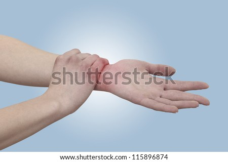 Acute pain in a woman wrist. Female holding hand to spot of wrist pain. Concept photo with Color Enhanced skin with read spot indicating location of the pain. - stock photo