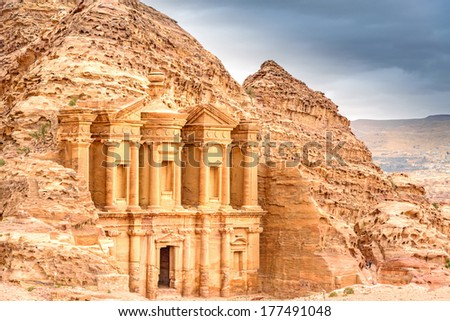 Ad Deir in the ancient Jordanian city of Petra, Jordan. It is known as the Monastery. Petra has led to its designation as a UNESCO World Heritage Site. - stock photo