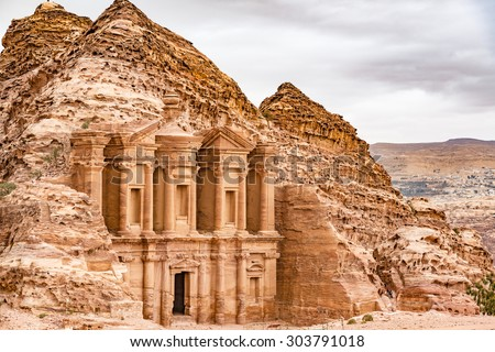 Ad Deir in the ancient Jordanian city of Petra, Jordan. Petra has led to its designation as a UNESCO World Heritage Site. Ad Deir is known as The Monastery. - stock photo