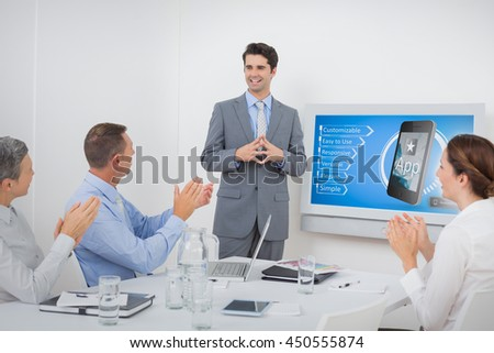 Ad for a new application against business team applauding their colleague - stock photo