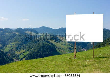 ad panel on a mountain view - stock photo