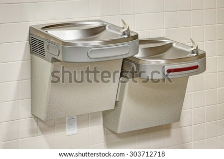 ADA accessible water fountains that meet building codes in new construction. - stock photo