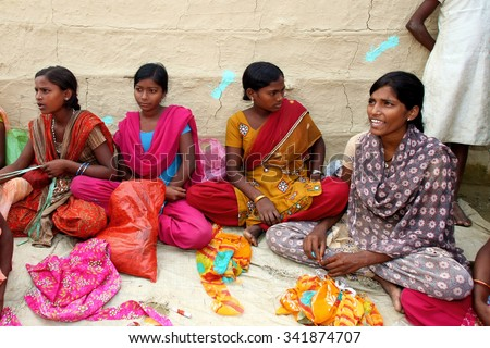 ADAPUR, INDIA - NOV 7: Unidentified Indian women on Nov 7, 2011 in Adapur, Bihar state, India. Bihar is one of the poorest states in India. The per capita income is 300 dollars.
