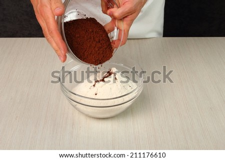 Add Cocoa Powder into Flour and Mixing. Making Chocolate Cookies. - stock photo