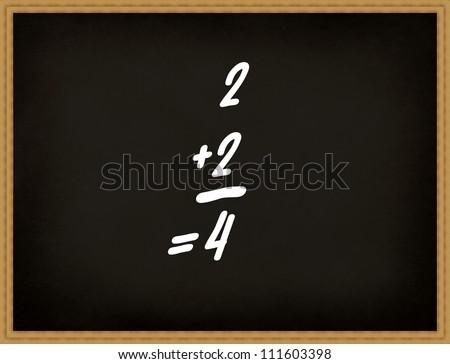 Add up on the blackboard or chalkboard, basic class of maths. - stock photo