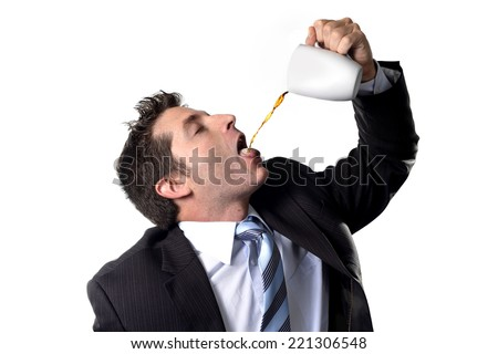 addict businessman in suit and tie drinking cup of coffee pouring stream on his mouth anxious and crazy in caffeine addiction and need to keep awake isolated on white background - stock photo