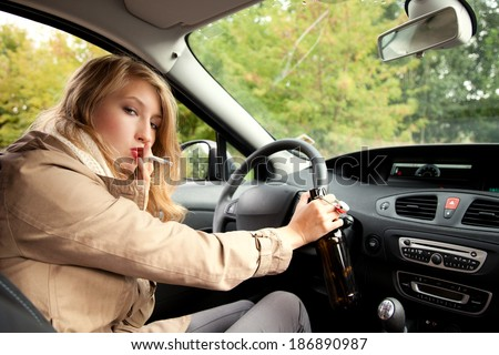 addiction smokingteen  woman  driving a car and drinking beer