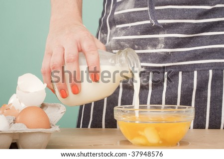adding milk to egg yolks
