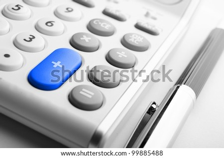 adding up figures concept with modern white calculator in office - stock photo