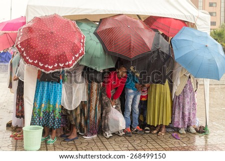 Addis Ababa: Apr 10:Ethiopian Orthodox followers stand undeterred by the pouring rain to observe Siklet, the crucifixion of Jesus Christ, a Medhane Alem Church on Apr 10 ,2015 in Addis Ababa, Ethiopia