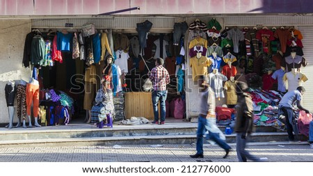 ADDIS ABABA. ETHIOPIA - DECEMBER 21, 2013: Clothes shop in Merkato market. Merkato market is the largest open air market in Africa. - stock photo