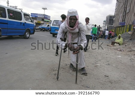 ADDIS ABABA, ETHIOPIA - MARCH 30: Unidentified man begs money in Mercato market area, Addis Ababa, Ethiopia, March 30, 2012. Mercato is the most criminal area always full of beggars and pickpockets.  - stock photo