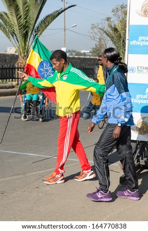 Addis Ababa, Ethiopia - November 24: World renowned athlete Haile Gebrselassie and 2013 NY Marathon winner Priscah Jeptoo at the 13th Edition Ethiopian Great Run, 24 Nov 2013, Addis Ababa, Ethiopia.