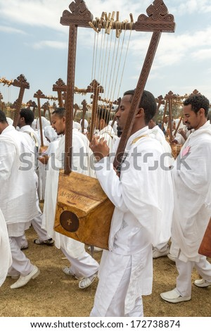 Addis Ababa - Jan 19: Clergy playing the Begena, a traditional string based instrument, during Timket celebrations of Epiphany, on January 19, 2014 in Addis Ababa. - stock photo