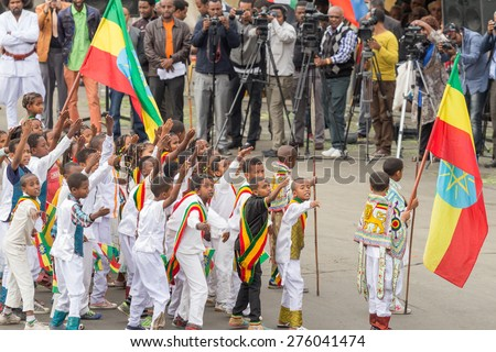 Addis Ababa - May 5: Young children dressed in traditional outfit perform in front of the Ethiopian President at the 74th anniversary of Patriots' Victory day on May 5, 2015 in Addis Ababa, Ethiopia. - stock photo