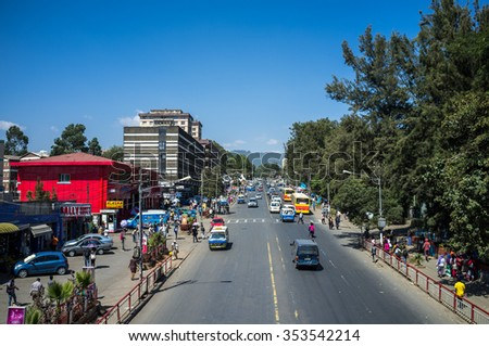 Addis Abeba, Ethiopia - December 3th 2015 - Trafic in downtown Addis Ababa in a sunny day, capital of Etiophia, Africa - stock photo