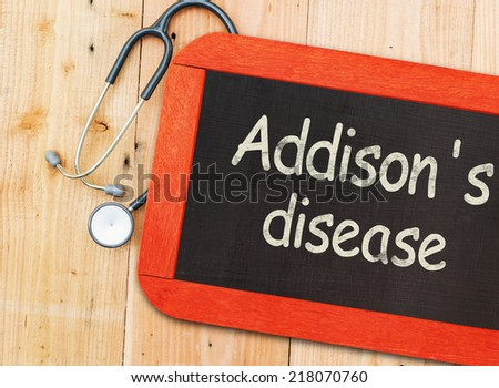 Addison's disease (adrenal insufficiency) written on chalkboard and stethoscope.  - stock photo