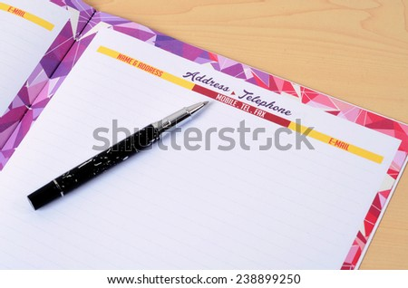 Address and telephone list on the wooden office table  - stock photo