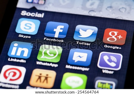 Adelaide, Australia - July 5, 2013: Close-up image of an iPhone screen with icons of social media apps - stock photo